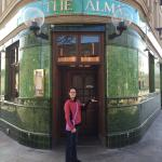 My daughter in front of the pub entrance