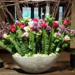Magnificent Hotel Lobby Floral Display: pink & white roses, purple lilacs, and fern leaves