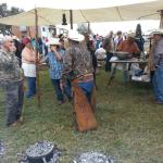 Ranch hand people talking to the guests.