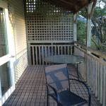 View of deck, featuring table and chairs