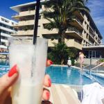 Piña colada from the bar, enjoying it by the pool
