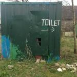 sign to toilets