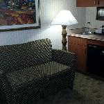 Seating area, microwave, and refrigerator make this almost a suite