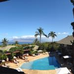 View of the poolside and the amazing backdrop of West Maui from the fitness room...a bonus to a