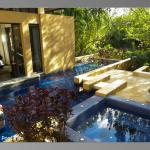 Pool area with hot tub at Sanctuary Villa
