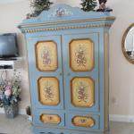 Rudy built this cabinet & Hildi decorated it.  What talent!
