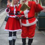 Mr &  Mrs Claus getting ready to join a packed train to the North Pole.
