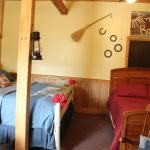 The Roost in the Barn is an extra large room with a king and a double bed