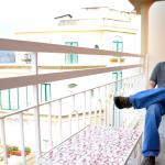 Husband sitting on other balcony!