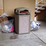 Trash remains out front of guest doors for three complete days now