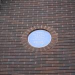 Blue plaque for Lenin's stay on rear of hotel building