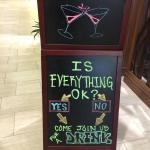 Sign by the bar