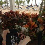 Day 1 - Jason sleeping by the pool with a beautiful view of the beach