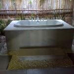 Outdoor tub in beach bungalow