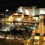 Night view of Castel dell'Ovo from rooftop Caruso restaurant