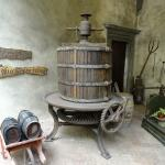 Ancient wine press and tools for viewing in Pazzi Courtyard