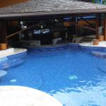 Family pool with built in seats, jacuzzi jets and tables