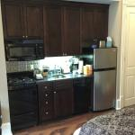 Kitchenette located at foot of Q Bed room 207