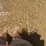 Putting toes in clear ocean for first time