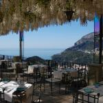 Hotel terrace with wisteria bower in full bloom