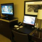 Room's TV and writing desk with montior and keyboard