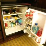 Room's ell-stocked refrigerator with paid drinks