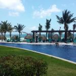 View of pool & ocean from walk-out room lounge chairs
