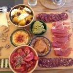 Fantastic charcuterie board with local cheeses and house-made hummus, tapanade, and membrillo.