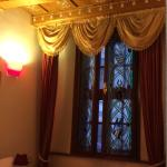 Lovely room with stained glass windows overlooking the street/square