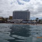 The hotel from the sea, with access via steps from hotel to beach