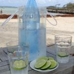 French sparkling water served on the beach