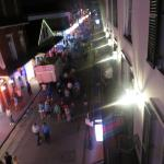 On the hotel room balcony overlooking Bourbon Street