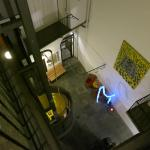 View down to hotel atrium, with view of funky yellow elevator.