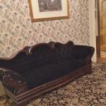 The couch in the living room where Mr. Borden was murdered.