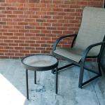 Dirt-covered balcony chair and table