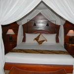 Curtained Bed with Firm Mattress