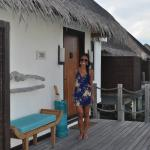 In front of our Sunset Overwater Bungalow!