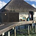 Another picture in front of our Sunset Overwater Bungalow!
