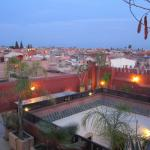 Rooftop terrace, overlooking the pool and the red city of Marrakesh.