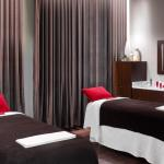 A true couple's massage room at Red Door Spa at The Garden City Hotel.