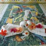 Beautiful quilt, towel art and flowers