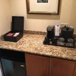 Coffee maker and refrigerator in room 838.