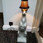 Peculiar dog with lamp on his head. (If you like the style.)