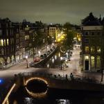 Escher Room canal view at night