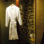 Gorgeous tile & glass shower with robes