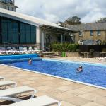 The outdoor pool, next to the indoor spa complex