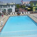 View from our second floor room of motel pool & retail strand