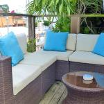 The shared 2nd floor sundeck has a sofa that you could chill or enjoy tapas