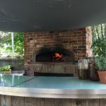 Outside bar and open-fired cooking pit