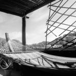 black and white of hammock outside penthouse